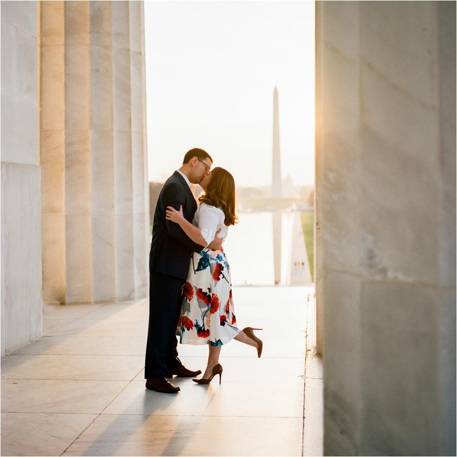 engaged couple kissing at sunrise