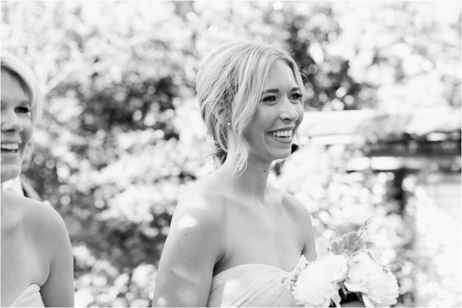bridesmaid smiling after the ceremony by charlottesville film wedding photographer, amy nicole photography