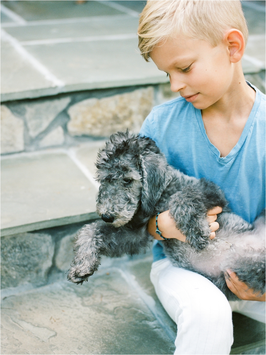young boy holding his first dog at home in charlottesville, va