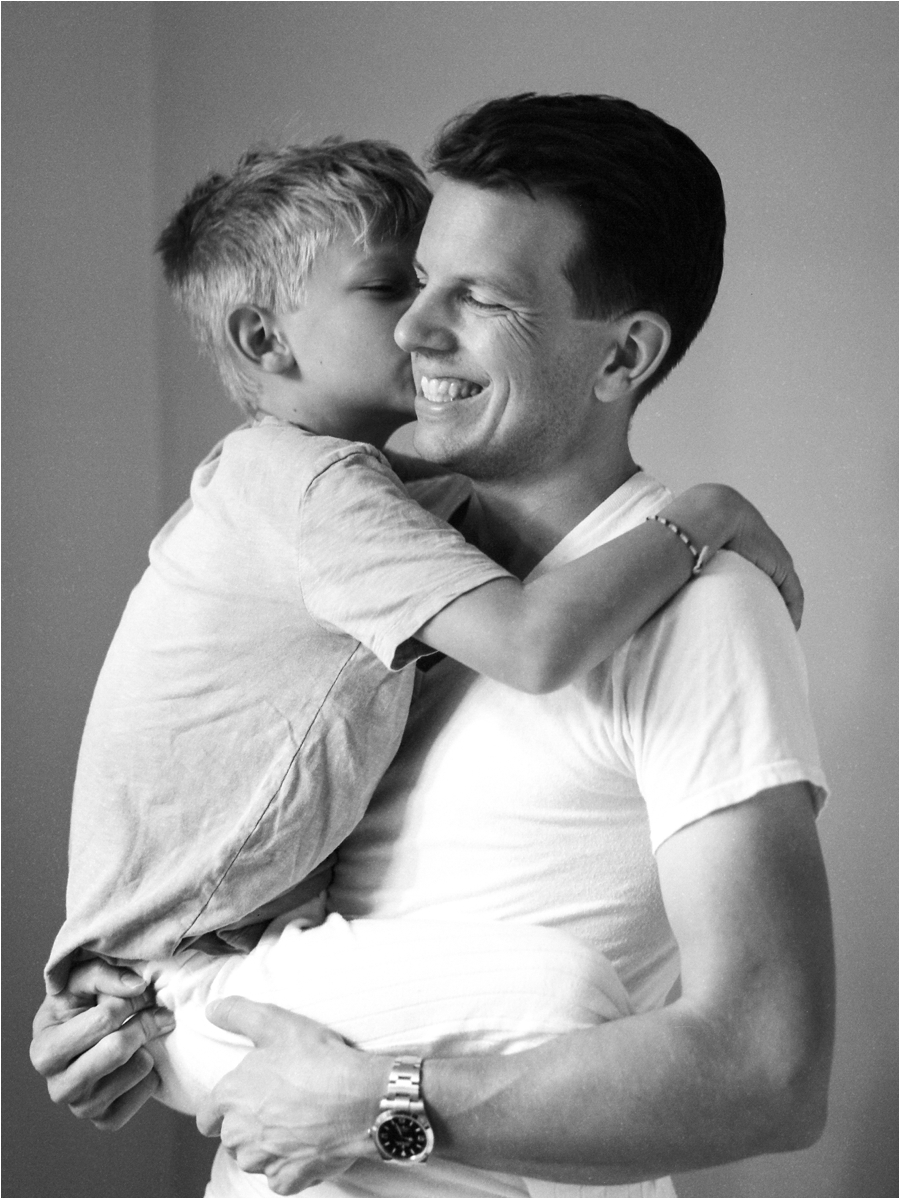 portrait of father holding son at home