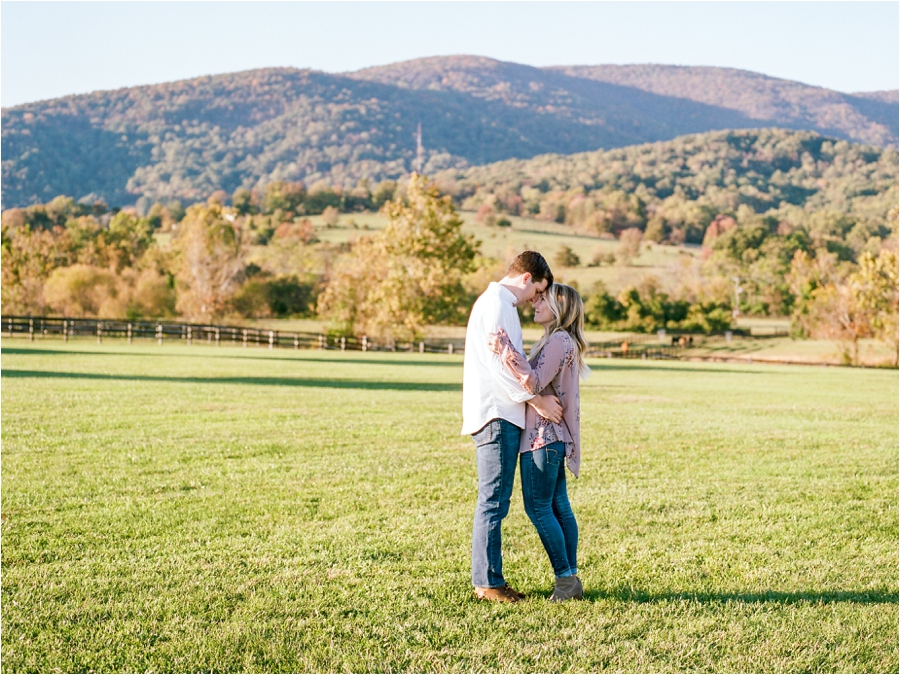 couple kissing in front of mountain range
