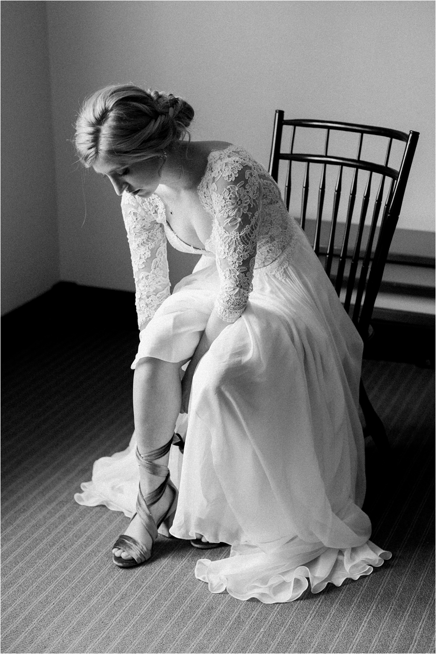 bride putting on shoes in hotel room